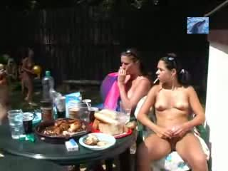 Nudist girls by the pool