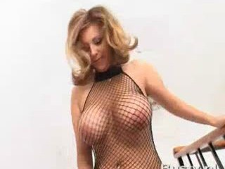 Girl in net top shaking her huge breast