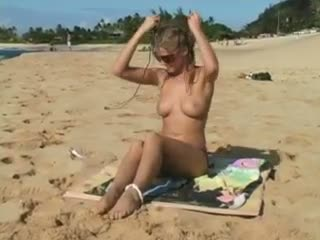 Carli Banks at the beach showing tits