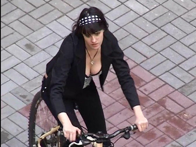 Bicycle babe showing her boobs