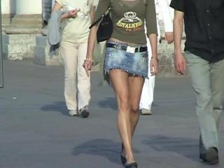 Long legs in short skirt  on the street