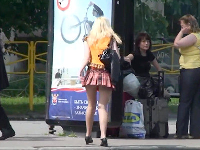 Babe in sexy mini skirt