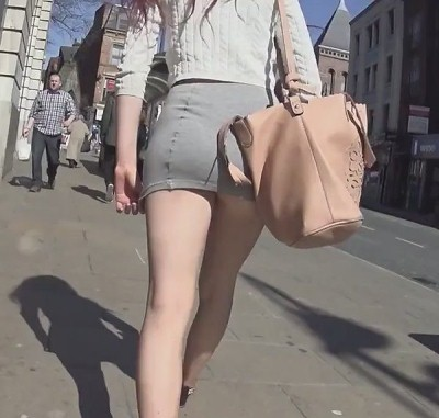 Girl walking on the street dressed in short skirt