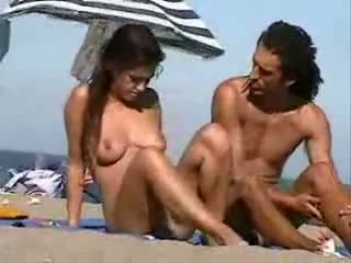 Nudist couple at the beach